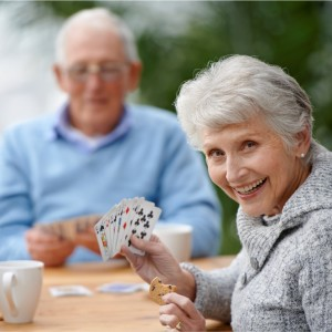 Seniors Playing Cards at Arbor Court Salina - Independant Living & Retirement Apartments